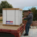 Unloading BuildBlock ICFs from the delivery truck