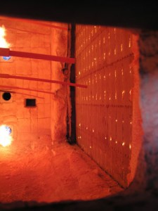 A view into the furnace about 10 minutes into the test. The plastic web connectors glow as they begin to burn.