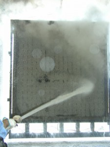 Steam explodes as the wall surface cools, etching the concrete finish about a 1/4 of an inch deep.