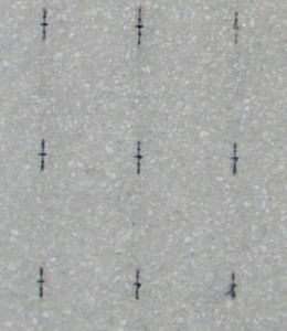 A close-up view of the smoothed, etched surface of the post-test wall shows very small web sections.