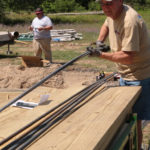 Team member preparing rebar to be cut and sorted