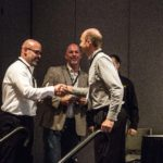 Alfonso Nieves (BuildBlock) and Joel Johns (Green Built) accept award