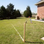 Laser level is used to set benchmarks and level the site before digging.