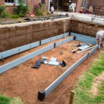 Footer and drain system is installed.