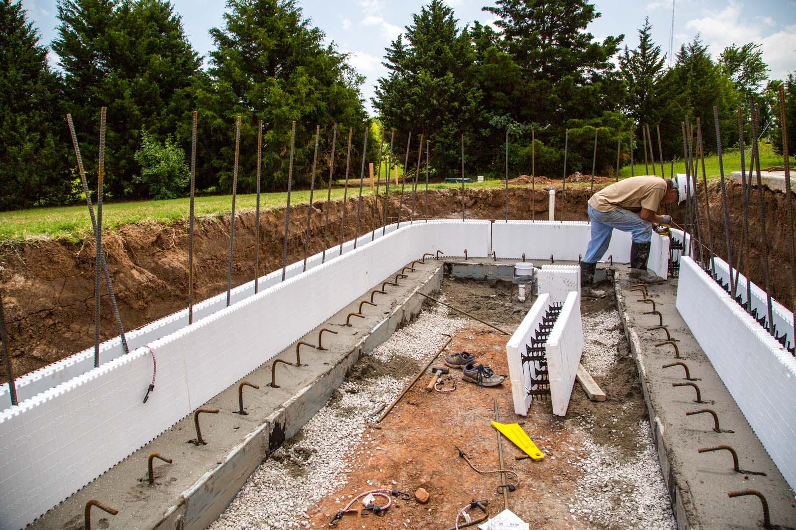 Icf swimming pools buildblock insulating concrete forms for What goes into building a house