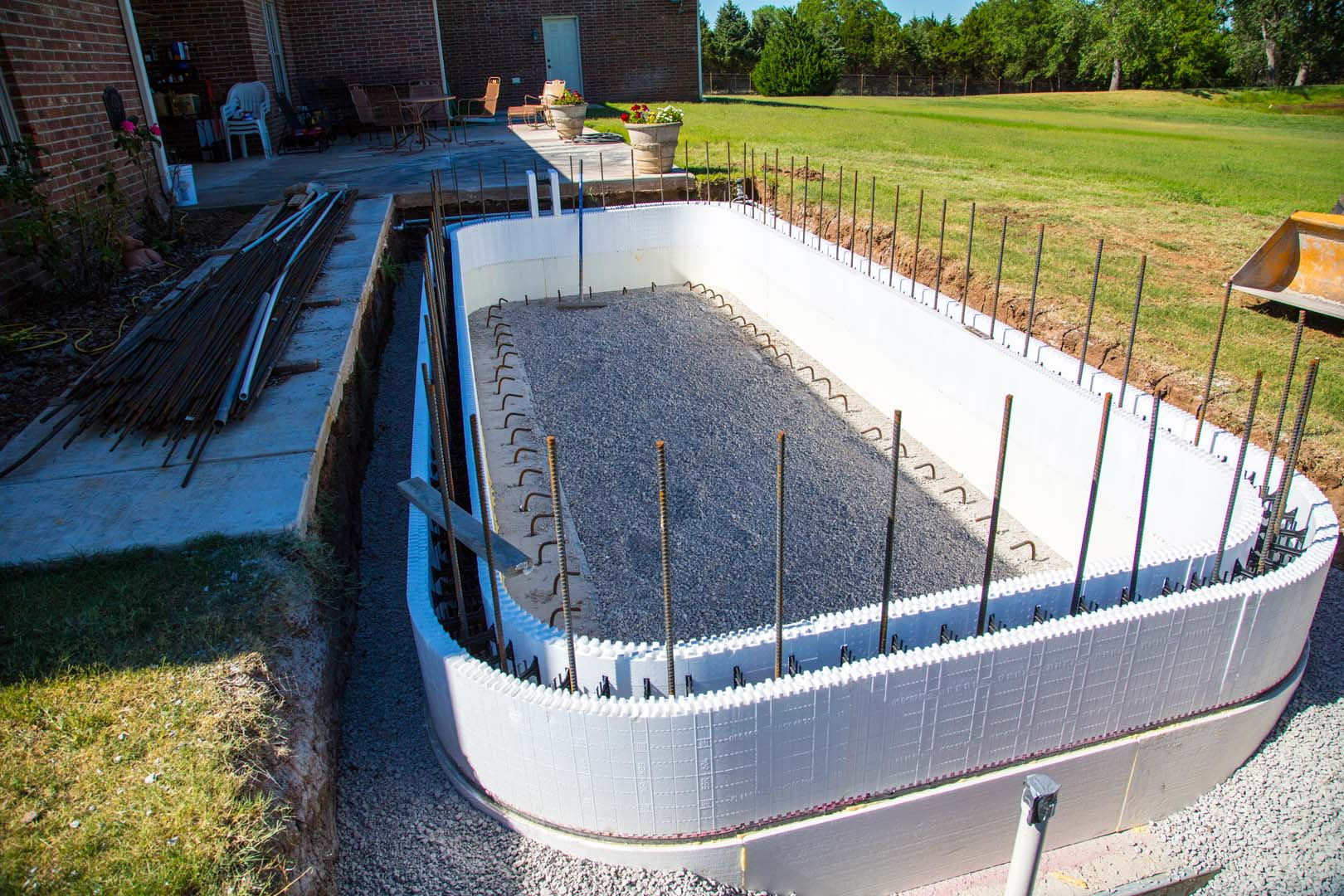 Icf swimming pools buildblock insulating concrete forms for Foam basement forms