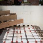 Rebar in the floor of the pool and wood framing for stairs