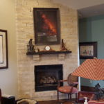 Living room with fireplace and artwork