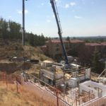 Using a boom pump to deliver concrete to the wall system