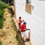 Wells Fargo volunteers setting the foundation of a Wells Fargo sponsored home. Rosa is the partner family mom and she has one older son with physical disabilities and a teenage daughter, who now live in the home.