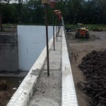 Vertical rebar extending from poured ICF walls
