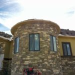 Completed radius wall with stone and windows