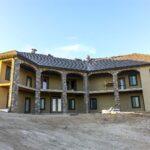 Back of house with finished stonework