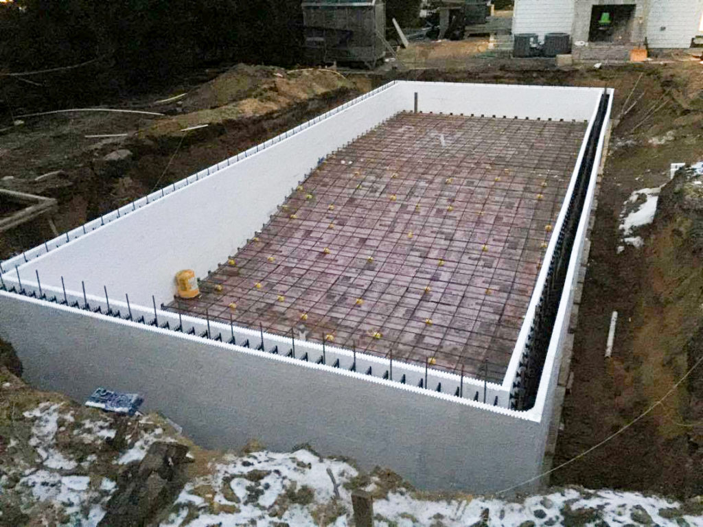 Icf swimming pools buildblock insulating concrete forms for Insulating basement floor before pouring