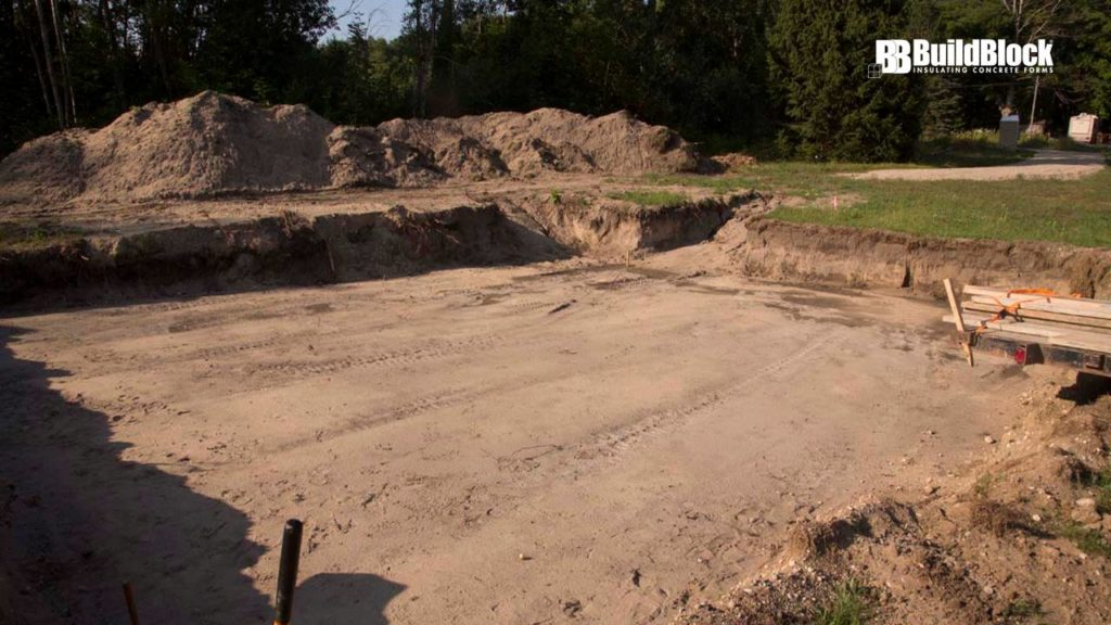 After zoning and building permit requirements are met, prepare the site for footings or slab on grade construction.